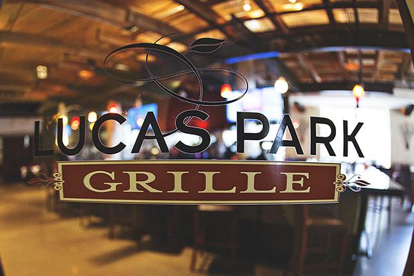 Front glass door Lucas Park Grille logo