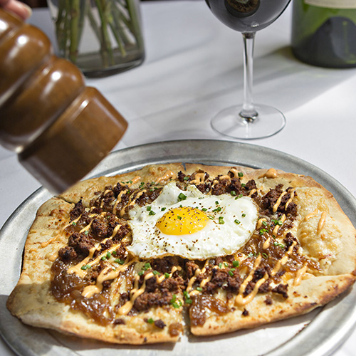 Chorizo sausage and egg flatbread fresh ground pepper red wine